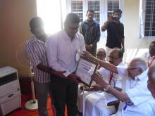 Award receiving from Justice Krishna Iyer