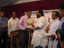 Receiving Chavara Award from Dr. K J Yesudas